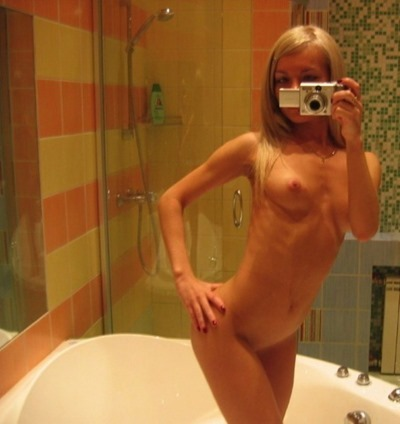 Naked girls in front of a mirror