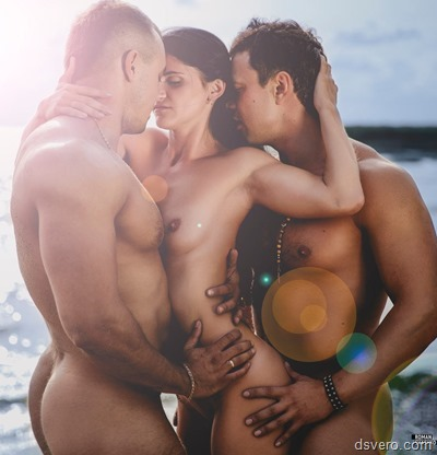 Two men and one naked girl